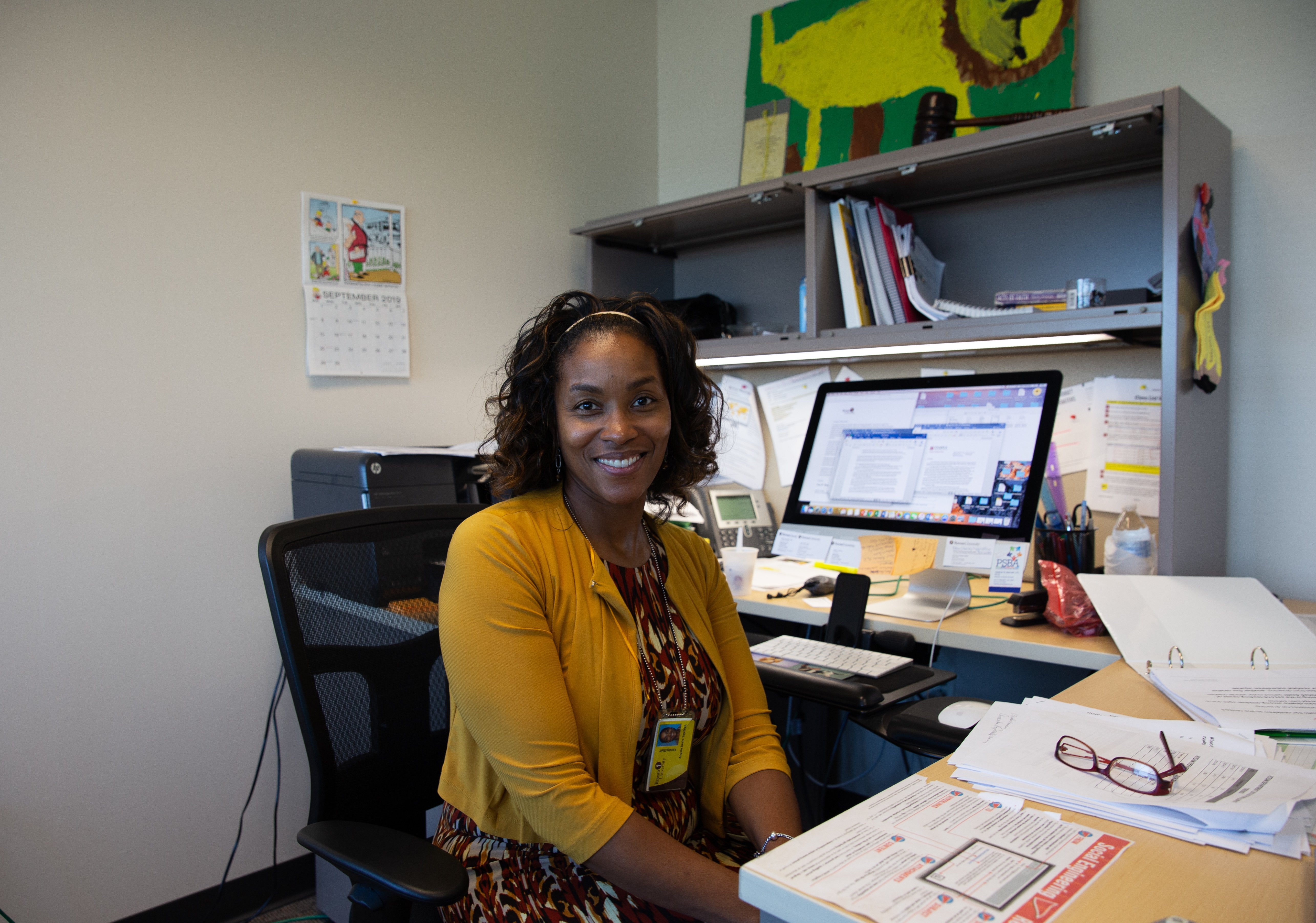 Dr. Angela Beale-Tawfeeq sitting at her desk.