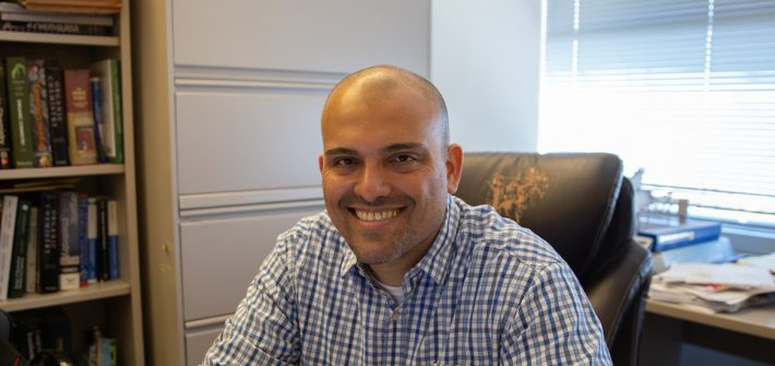 Rowan chemistry professor Dr. Moura-Letts in his office