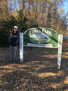 Jack stands by the sign for Ceres park.