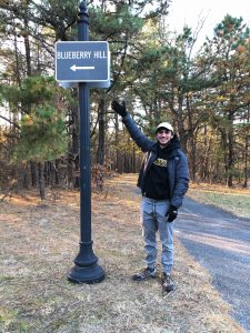 Jack points to the sign in Blueberry Hill park.