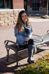 Biological Sciences major Brianna Nghiem sits on a bench outside of Barnes & Noble