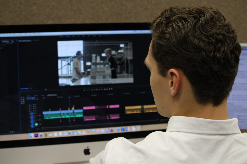 Adam Clark edits his movies with Adobe Premiere Pro while sitting in one of the many editing labs inside Bozorth Hall.