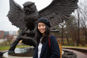 Nam Phuong Nguyen Hoang poses outside in front of the Rowan owl statue