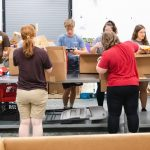 students sorting food at the south jersey food bank