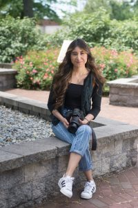 Student portrait of Journalism major Iridian outside on Rowan's campus
