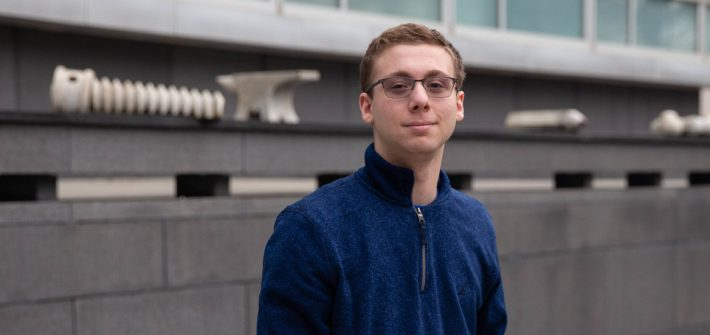 Chemical Engineering major Dylan Snyder outside Rowan Hall