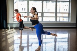 Sabrina is dancing in her modern dance class with one of her classmates.
