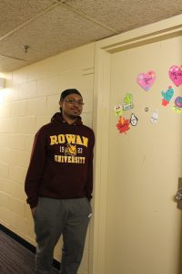 jalen in front of his dorm room
