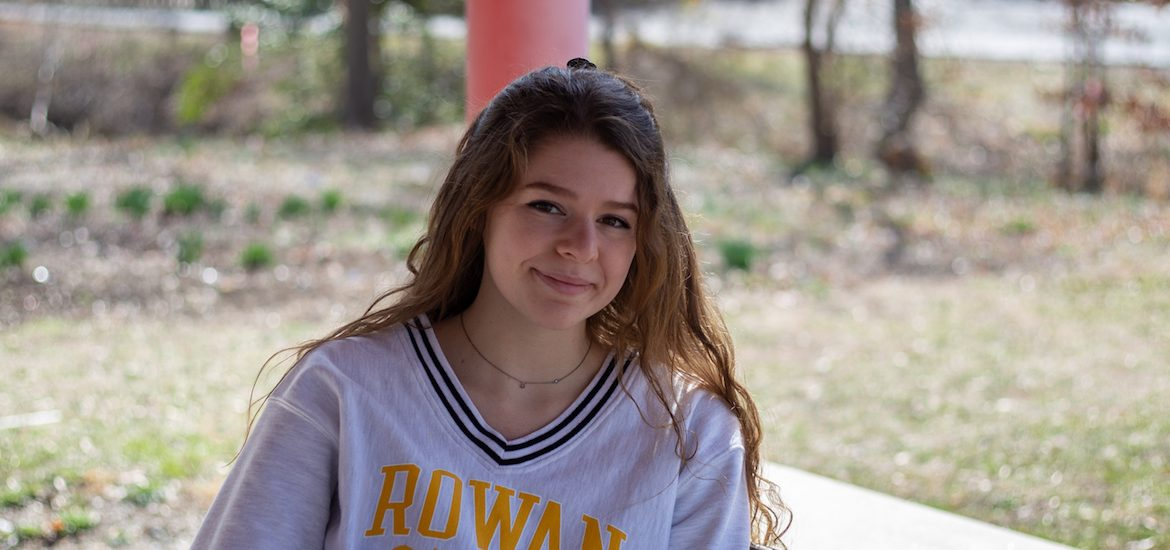 Rowan University junior Abby Broschard sitting outside.