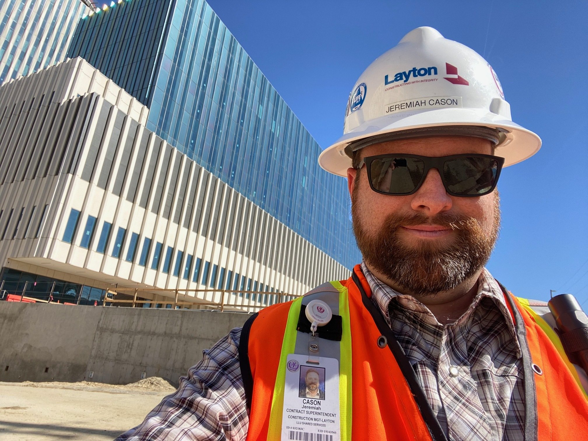 Jeremiah takes a selfie at a construction site.