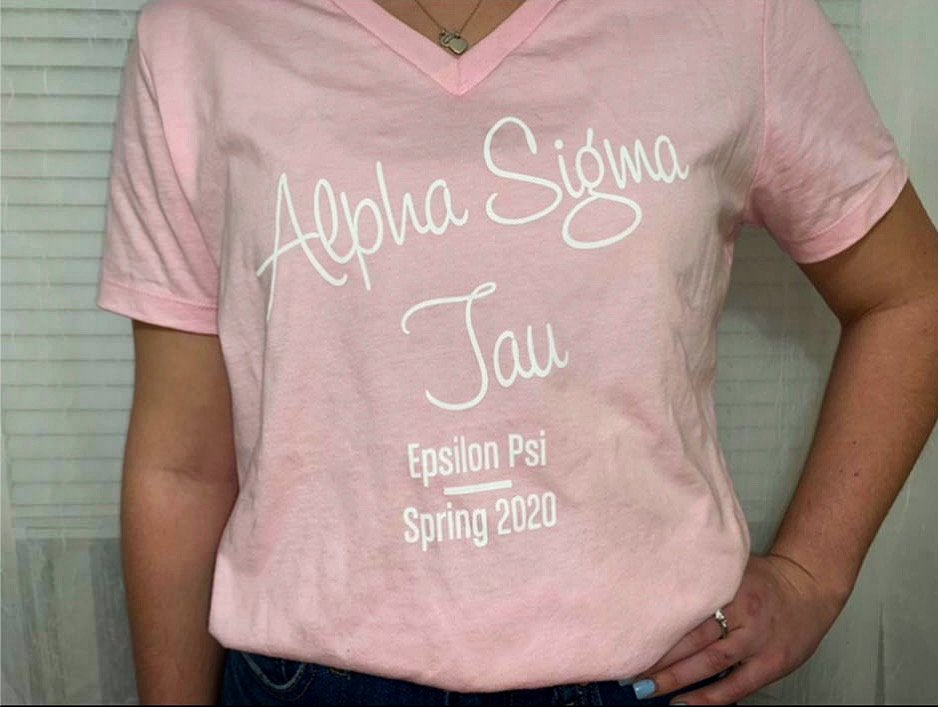 Pink Alpha Sigma Tau recruitment shirt.