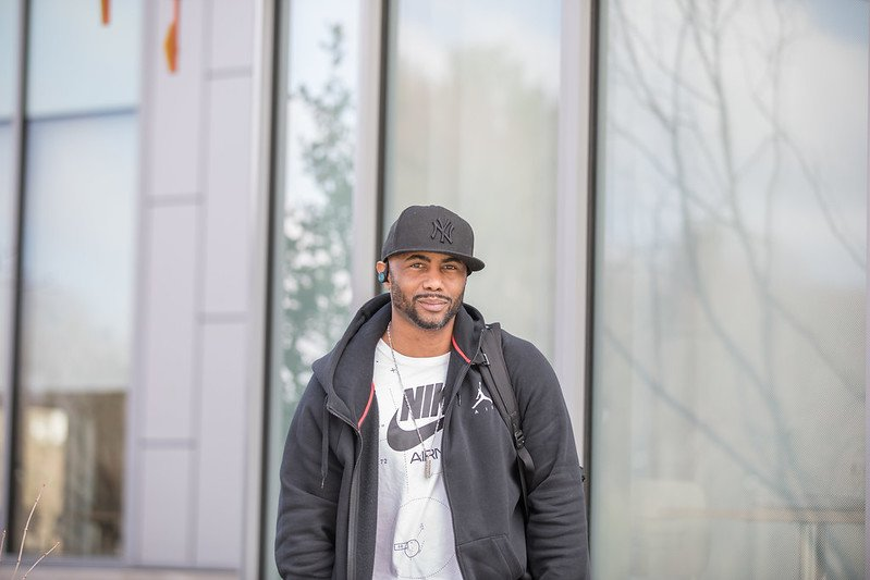 Rasheed stands outside the Rohrer College of Business.