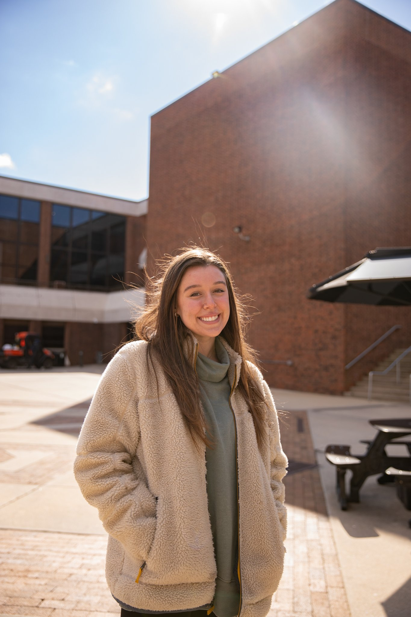 Roxy Urso poses for a photo outside of the Student Center.