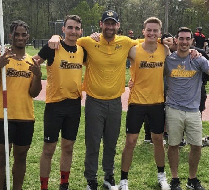 Daniel (second on right) with some teammates and coach after winning the NJAC title