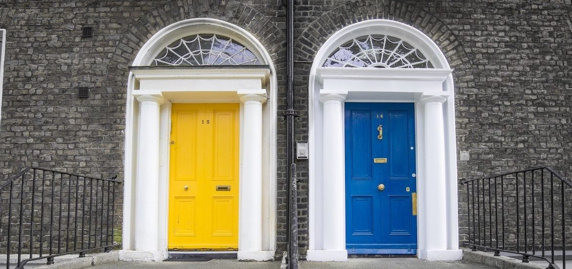 Stock image of a yellow door and a blue door side by side.