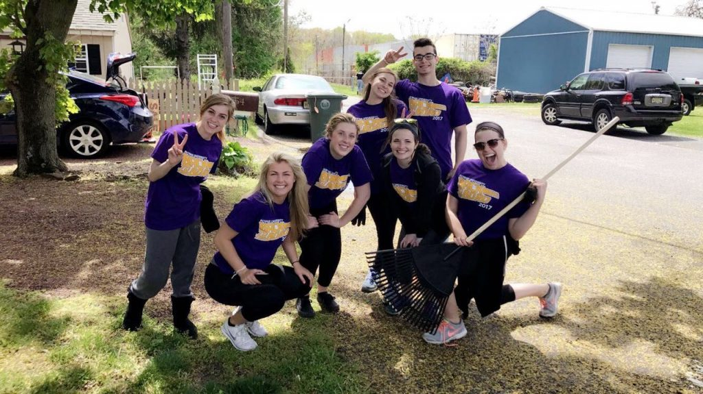 Devon (second from left) and friends participated in a community-wide clean-up event.