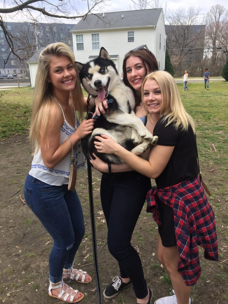 Devon (left) with friends (and one furry friend)