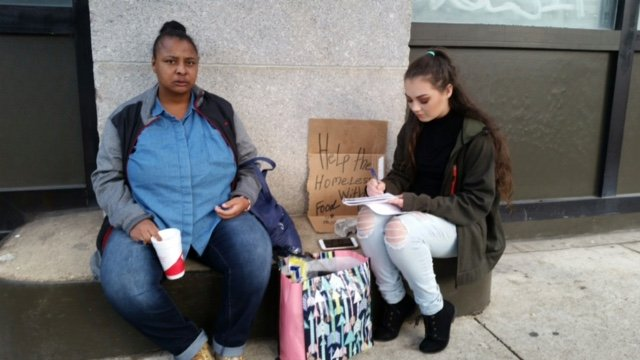 Rowan student Lauren Purnell interviews a subject for her blog on the homeless