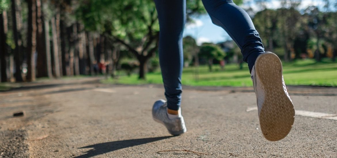 A stock image of a close up of running feet.