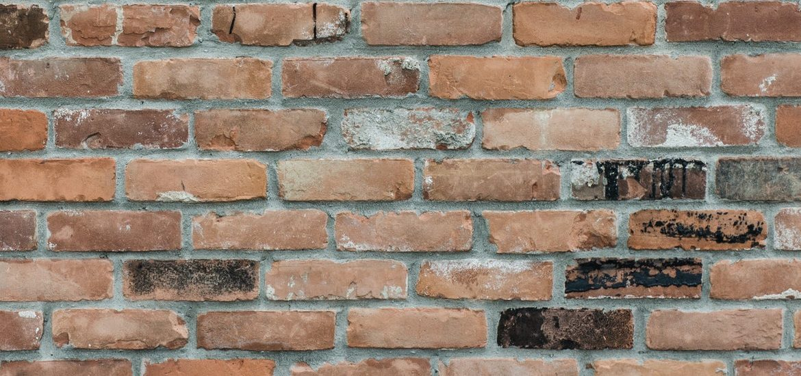 Stock image of mixed color reddish brick.