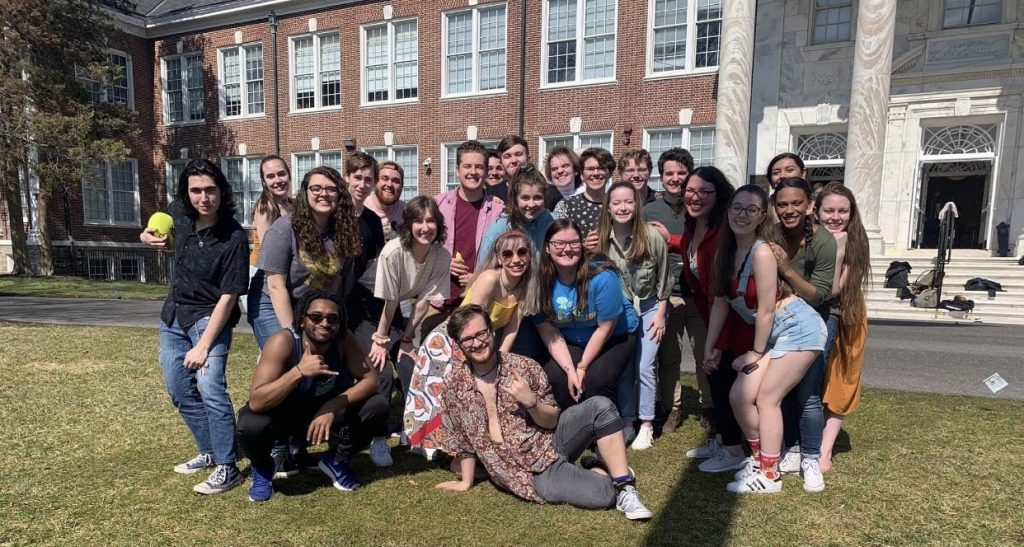 Large group of theatre majors pose together in front of Bunce Hall.