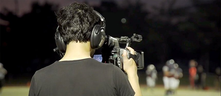 A cameraman films an athletic event