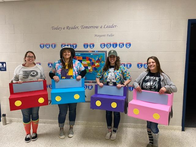 Tabitha stands with other teacher candidates dressed in costumes for Read Across America.
