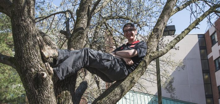 Troy Becker in a tree on campus.
