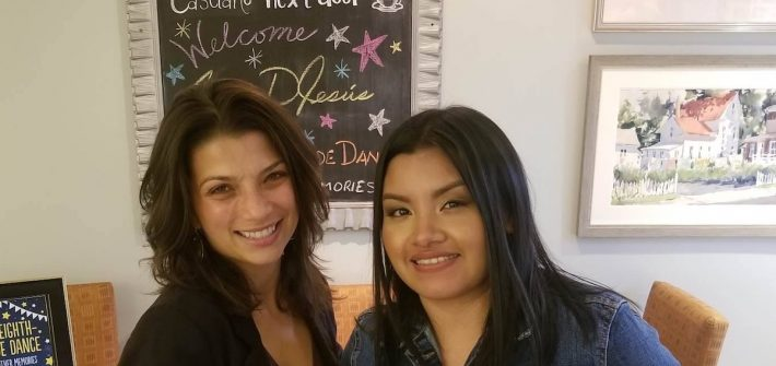Rosalba standing with her cooperating teacher.