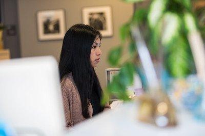 Alejandra works in Enterprise Center on a desktop computer.