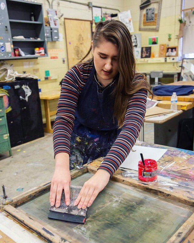 Leann working on a screen printing in the studio at Westby Hall on campus.