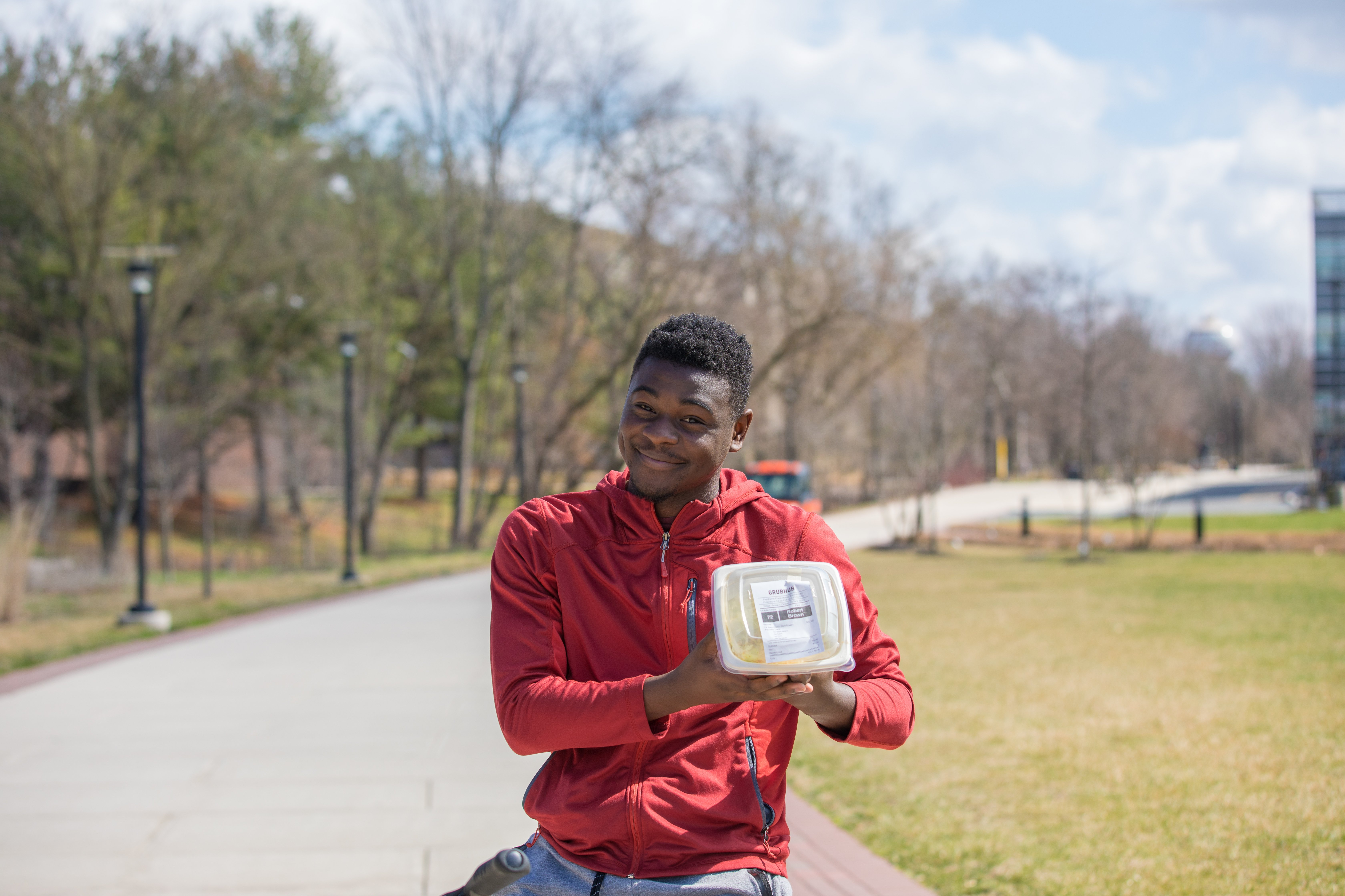 Robert Brown poses with a Freshens rice bowl on campus.