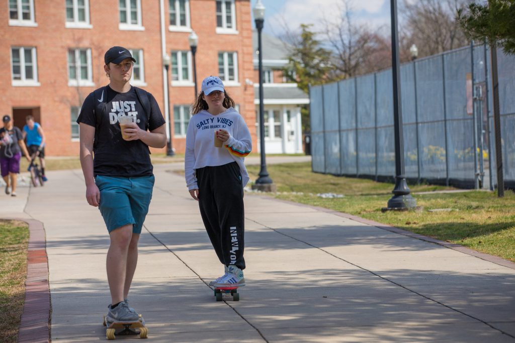 Rowan accounting major Robert and a friend skate outside of Willow Hall.