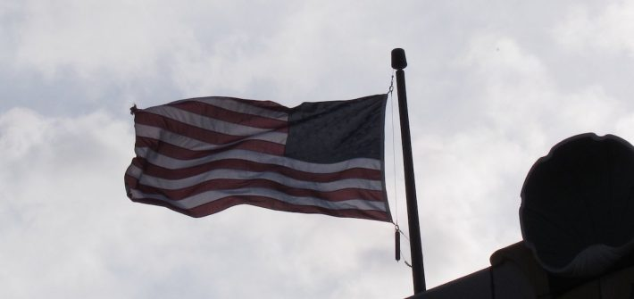 An American flag flying in the wind.
