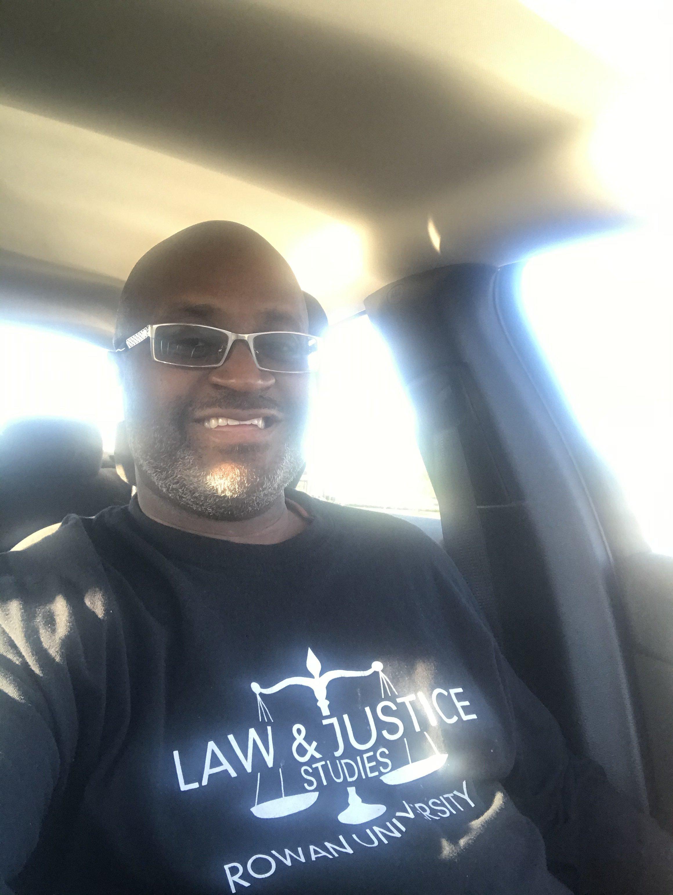 Carl Watkins in a Law & Justice t-shirt.