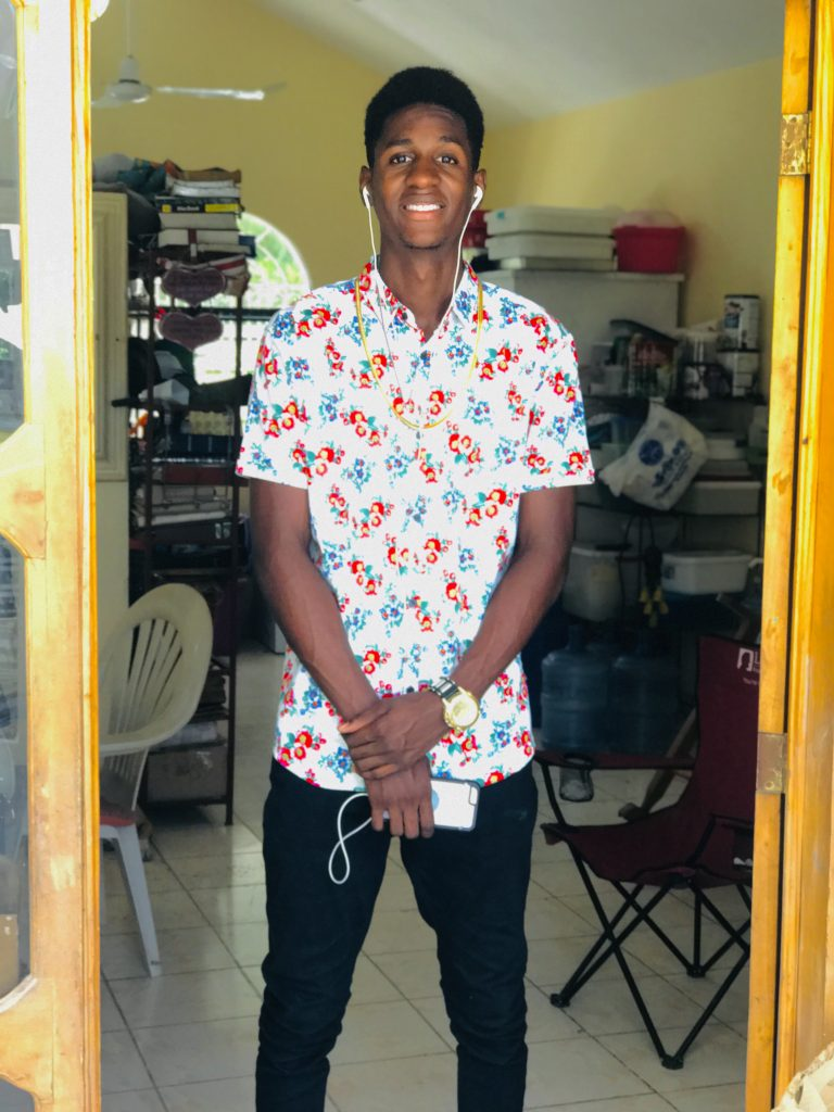 Computer science major Dean Julien in his native Haiti