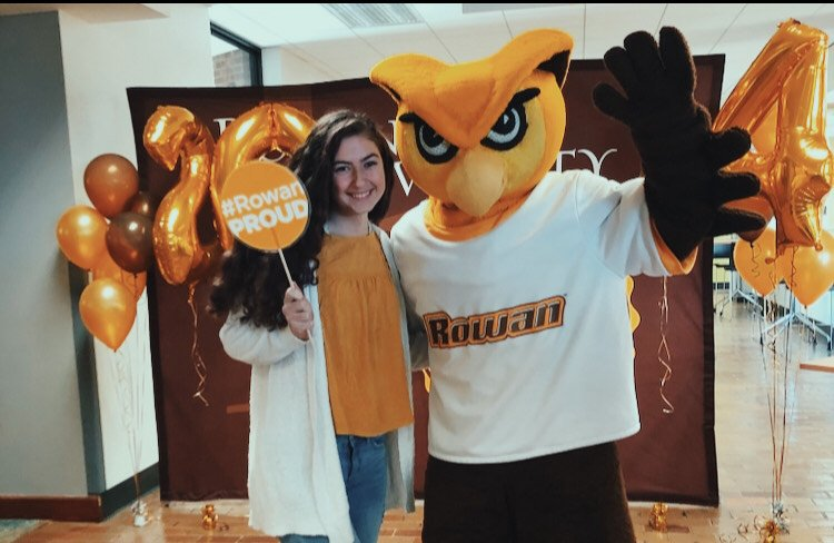 Casey posing with Rowan University's mascot owl, Whoo R U.