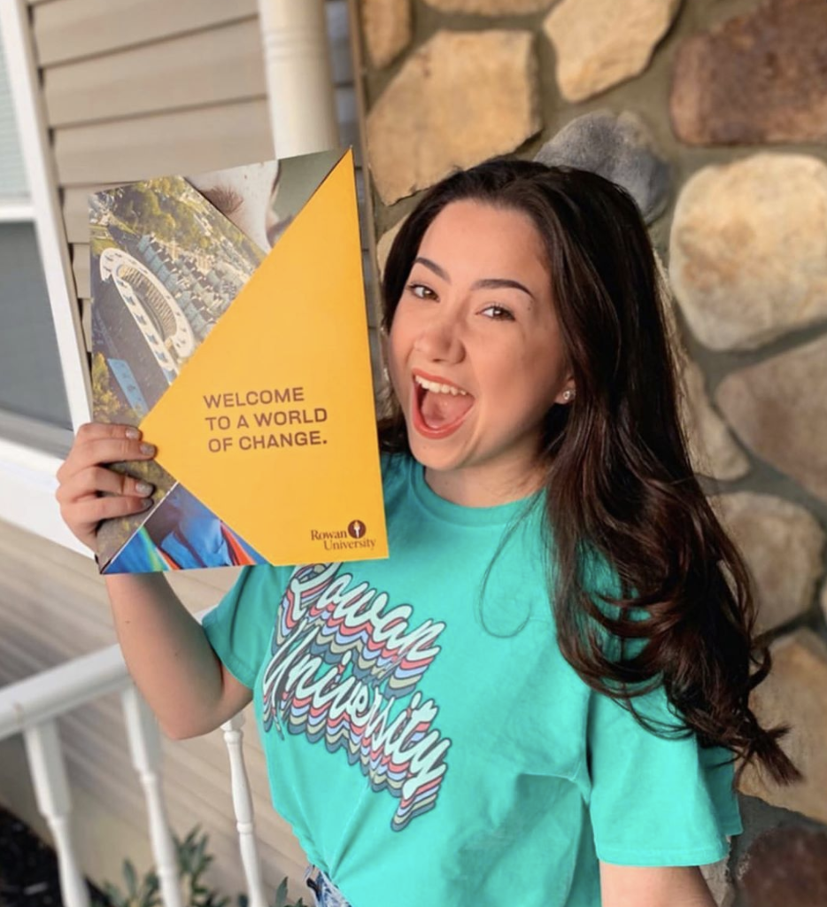 Maia proudly displays her #Rowan2024 acceptance package from Rowan University.