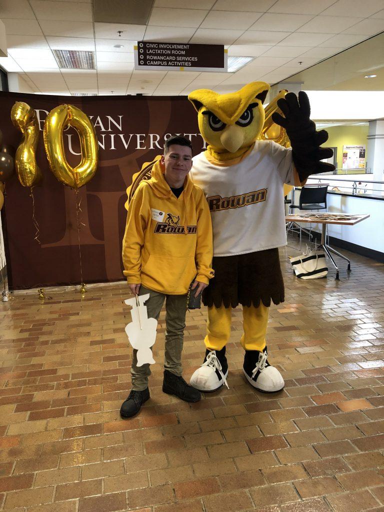 Logan poses with Rowan University mascot, Whoo RU.