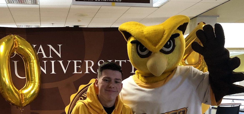 Logan poses with Rowan University's mascot.