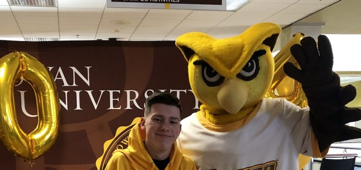 Logan poses with Rowan University's mascot.