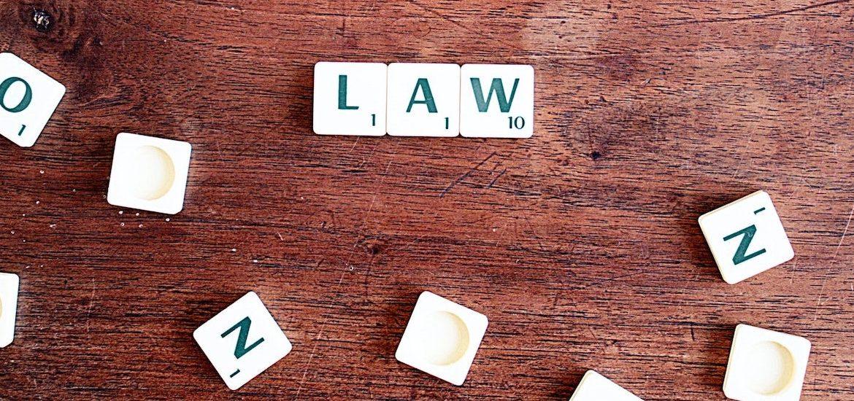 Stock image of Scrabble tiles spelling law.