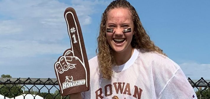 Bella wearing Rowan gear with a foam Rowan finger.