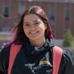 Brianna poses for a photo outside Business Hall.