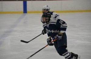 Matt playing ice hockey.