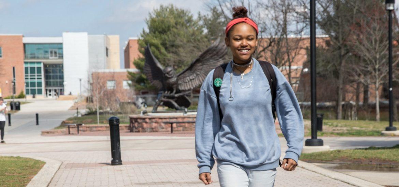 Hajah walks around campus.