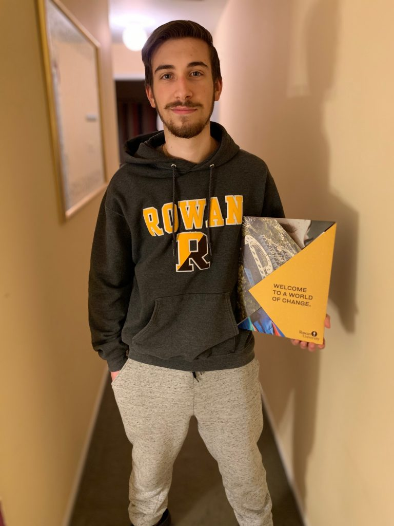 Music Education major and incoming freshman Anthony Demateis poses with his acceptance letter.