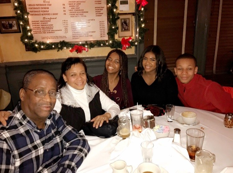 Group photo of Jasmine Dennis with her family.
