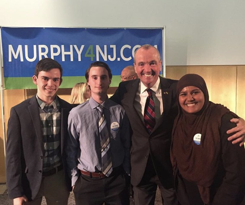 Kazi Hafiza with then-candidate Phil Murphy and other students