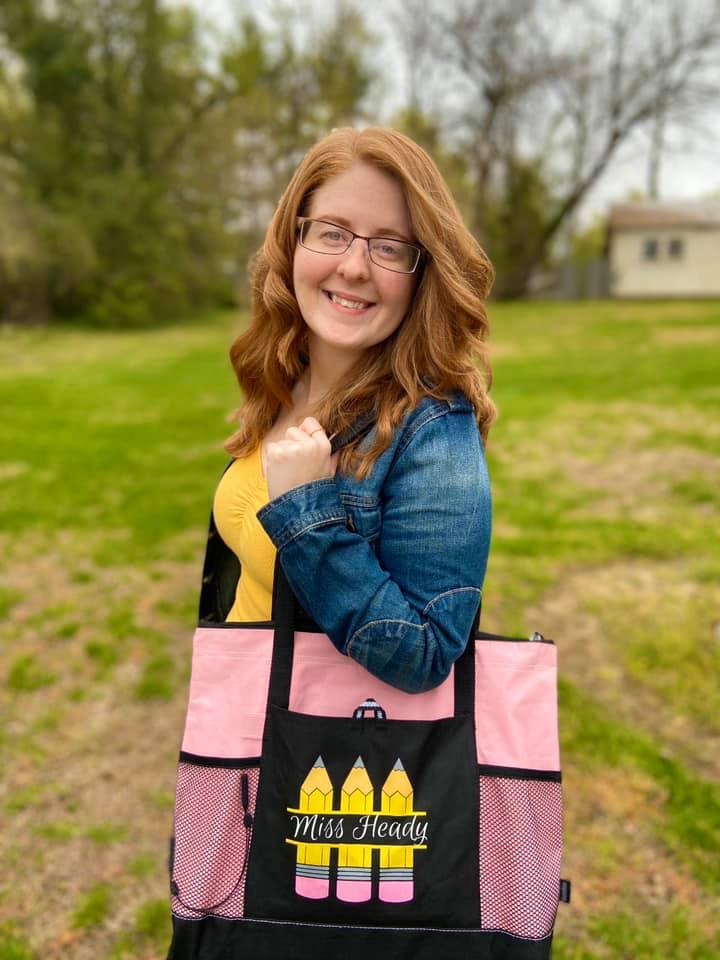 Jessica Heady holding a bag that says Miss Heady on it